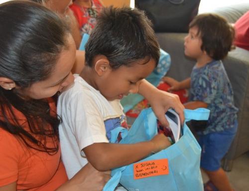 Distribuzione di kit scolastici alle famiglie in povertà di Milano